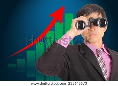 Businessman search stock through binoculars for check and predist trend marketing - stock photo