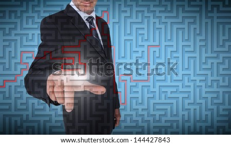 Businessman selecting a labyrinth on blue background - stock photo