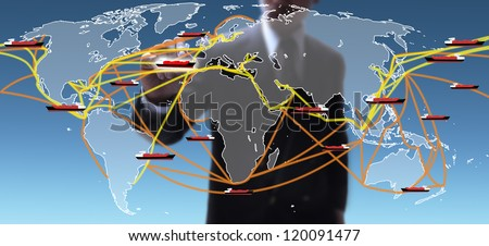 businessman selecting lane on the large world shipping routes map. - stock photo