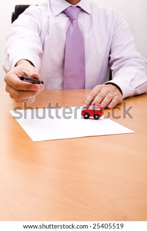 businessman selling a new car at his office (selective focus) - stock photo