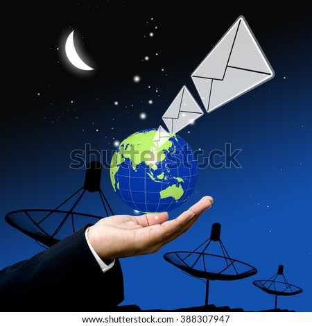 Businessman send email at night concept - stock photo