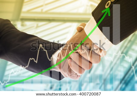 Businessman shake hands after success communication for corporate business together. - stock photo