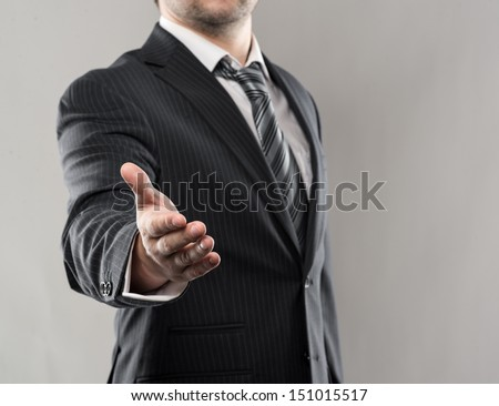 Businessman shaking hand of his business partner in agreement. Studio shoot of successful man's hand welcome.  - stock photo