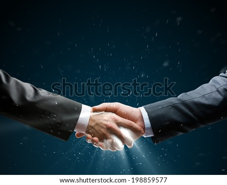Businessman shaking hand to partner with succesful deal - stock photo