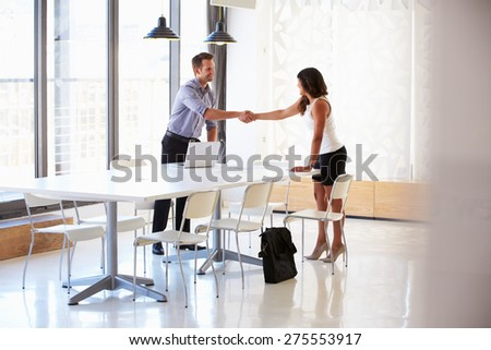 Businessman shaking hands with a job applicant - stock photo