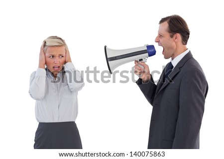 Businessman shouting at colleague with his bullhorn on white background - stock photo