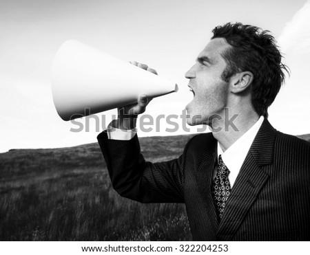 Businessman Shouting Megaphone Field Concept - stock photo
