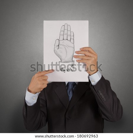businessman show book of  Hand raised with MY VOTE text as concept - stock photo