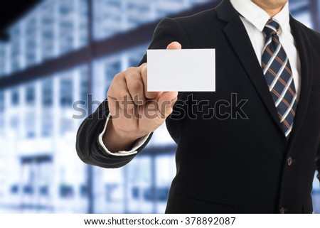 Businessman show business card to introduce himself.  - stock photo
