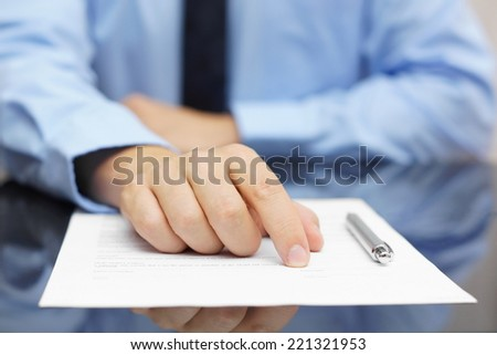 businessman show client where to sign - stock photo
