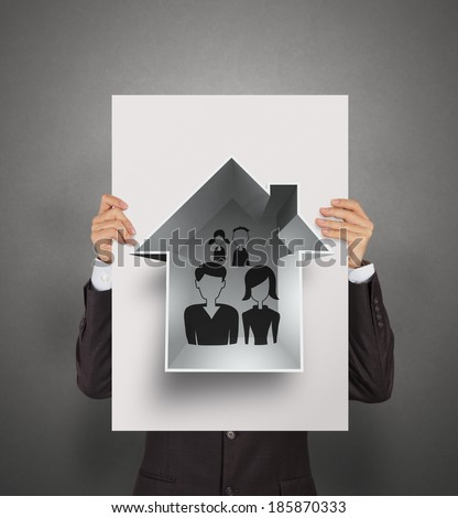 businessman show hand draw family and house on poster as insurance concept - stock photo