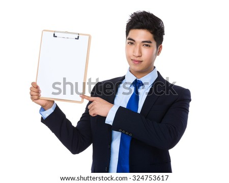 Businessman show with clipboard - stock photo