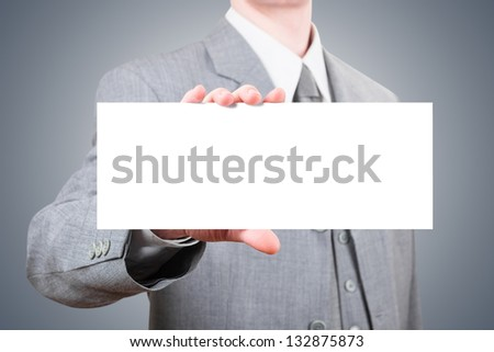 Businessman showing a big blank card - stock photo
