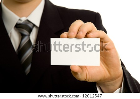 Businessman showing a blank business card - stock photo