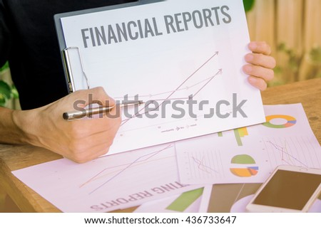 Businessman showing a rising graph, representing business growth. - stock photo