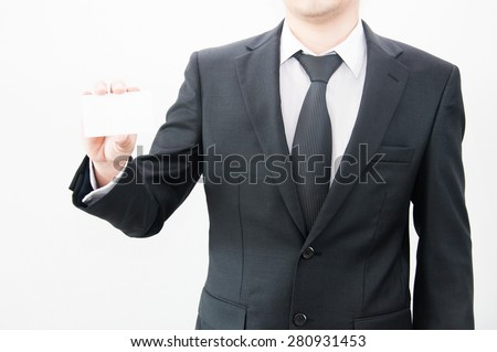 Businessman showing blank white business card with copy space ready for contact info - stock photo