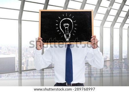 Businessman showing board against room with large window looking on city - stock photo