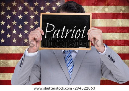 Businessman showing board against usa flag in grunge effect - stock photo