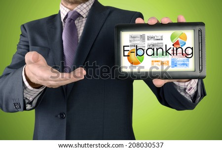 Businessman showing business concept on tablet - E-banking - stock photo
