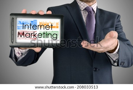 Businessman showing business concept on tablet - Internet Marketing - stock photo