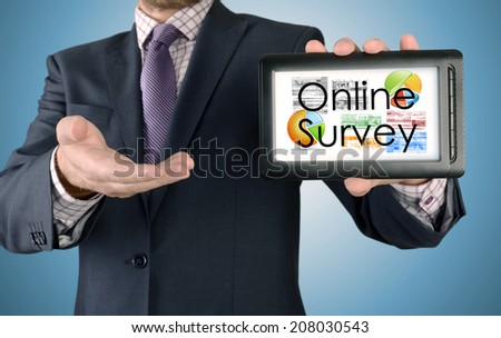 Businessman showing business concept on tablet - Online Survey - stock photo