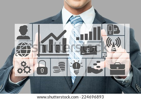 Businessman showing business plan, graph and chart - stock photo