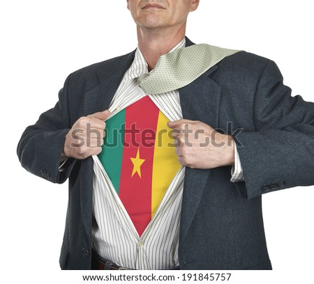 Businessman showing Cameroon flag superhero suit underneath his shirt standing against white background - stock photo