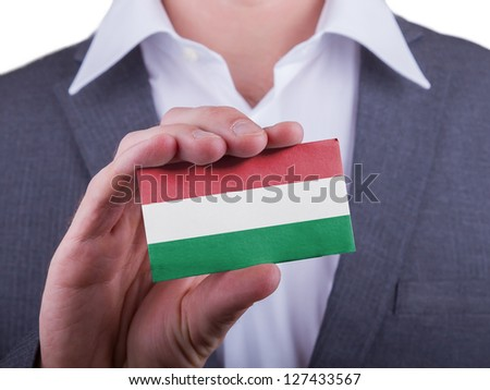 Businessman showing card, matte paper effect, Hungary - stock photo