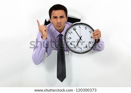 businessman showing clock looks annoyed - stock photo