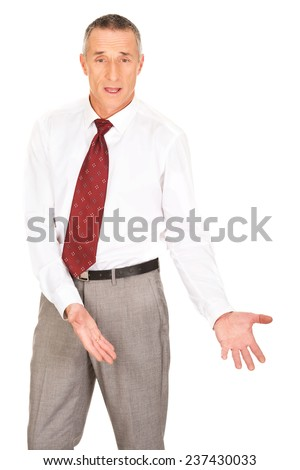 Businessman showing copyspace on the floor. - stock photo