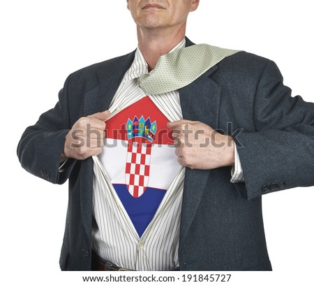 Businessman showing Croatia flag superhero suit underneath his shirt standing against white background - stock photo