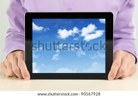 Businessman showing digital frame with cloudscape on screen. Concept image on a cloud-computing theme. - stock photo