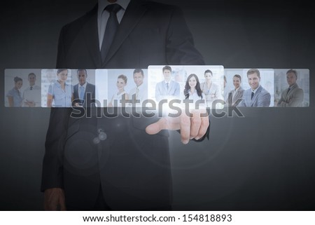Businessman showing digital interface of business people - stock photo