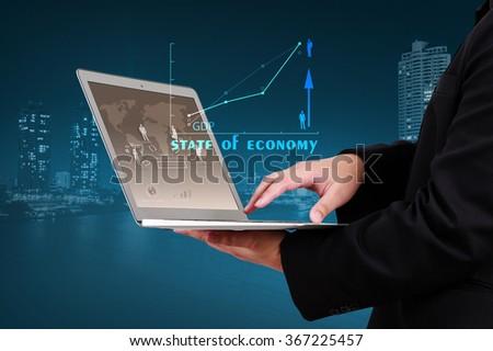businessman showing economic trend technology background - stock photo