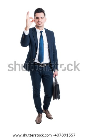 Businessman showing excellent or perfect gesture standing isolated on white background - stock photo