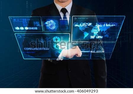businessman showing glow technology screen floating from hi-tech watch - stock photo