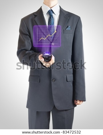 Businessman showing graph on holographic screen reporting success. - stock photo