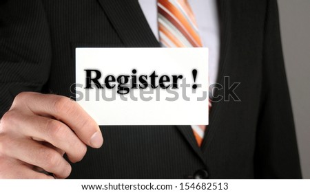 businessman showing his business card with the message register - stock photo