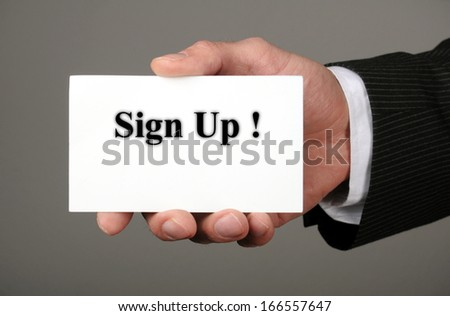 businessman showing his business card with the message sign up - stock photo