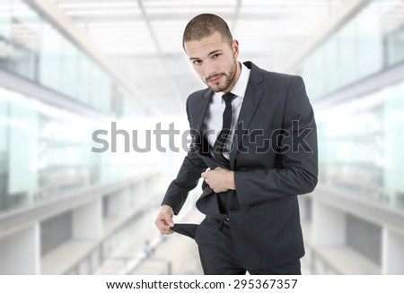 businessman showing his empty pocket, at the office - stock photo