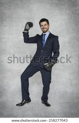 businessman showing his muscles - stock photo