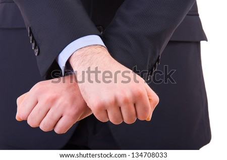 Businessman showing jail gesture with his hands. - stock photo