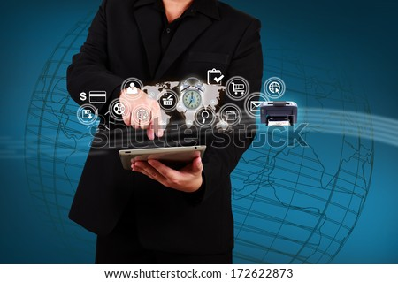 Businessman showing map and icon application on virtual screen. Concept of online business. - stock photo
