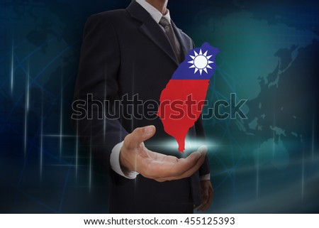 Businessman showing map of Taiwan on globe background - stock photo