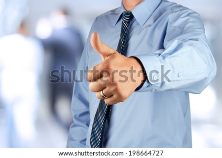 Businessman showing OK sign with his thumb up.  - stock photo