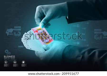 Businessman showing playing cards - stock photo