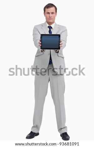 Businessman showing screen of his tablet computer against a white background - stock photo