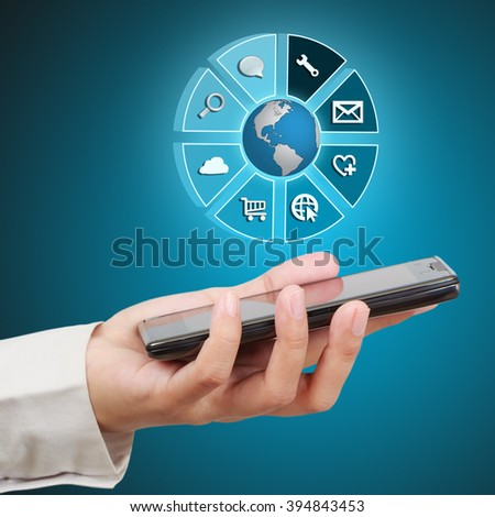 Businessman showing smartphone with icon application on virtual screen. Concept of online business. - stock photo