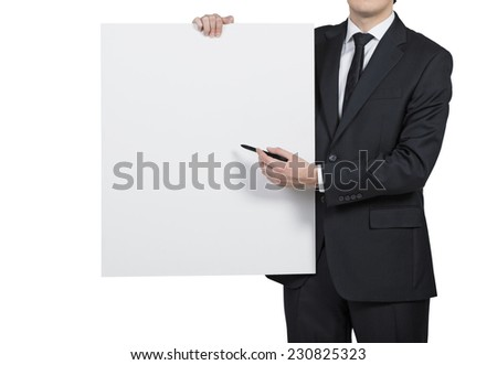 Businessman showing something on the white board. - stock photo