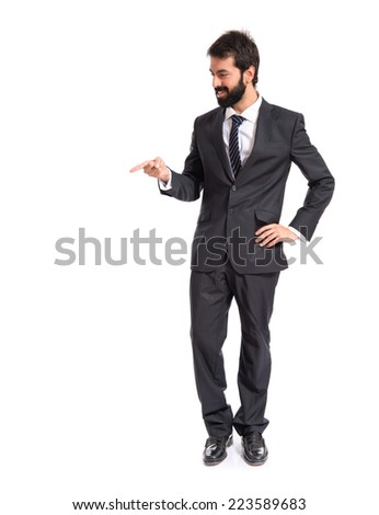 Businessman showing something over isolated white background  - stock photo